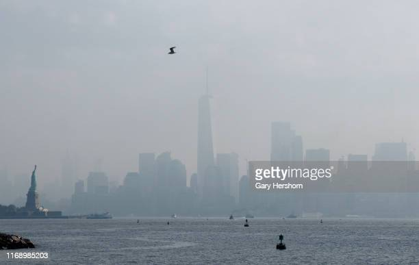 The skyline of lower Manhattan in New York City is shrouded in haze and humidity on August 19, 2019 as seen from Bayonne, New Jersey.