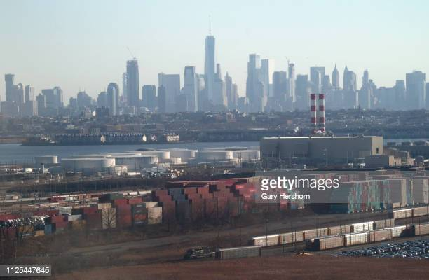 The skyline of lower Manhattan in New York City rises above Port Newark shortly after sunrise on January 27 2019 in Newark New Jersey