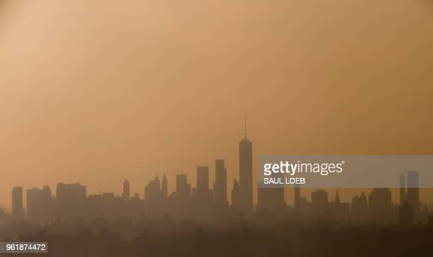 The skyline of Manhattan is seen at sunset in New York May 23 2018