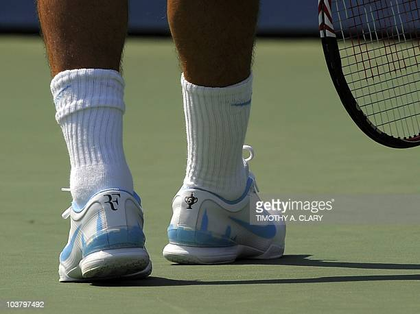 The skyline of Manhattan on the shoes of number two seed Roger Federer of Switzerland during his match against Andreas Beck of Germany during their...