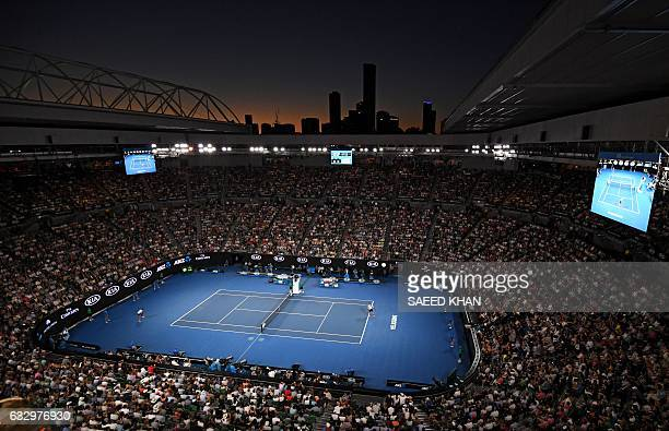 The skyline of Melbourne is pictured at sunset as Roger Federer of Switzerland plays against Rafael Nadal of Spain in the men's singles final on day...