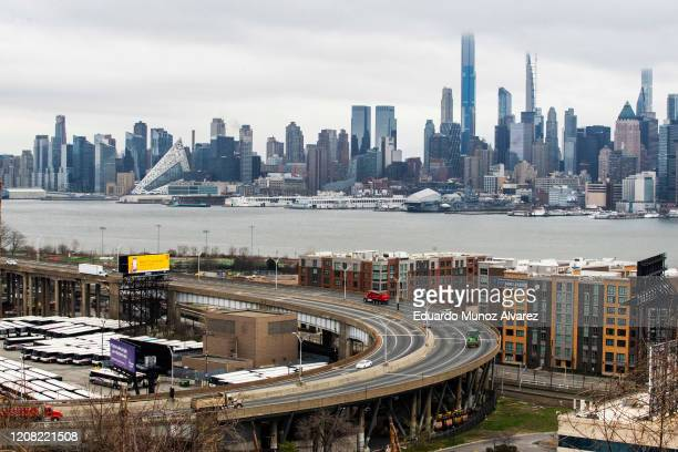 The skyline of New York City is seen as people commute between New Jersey and New York on March 25 2020 in Weehawkeen New Jersey Across the country...