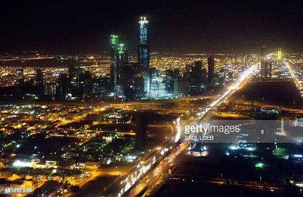 The skyline of Riyadh Saudi Arabia March 28 is seen at night in this aerial photograph from a helicopter AFP PHOTO / Saul LOEB