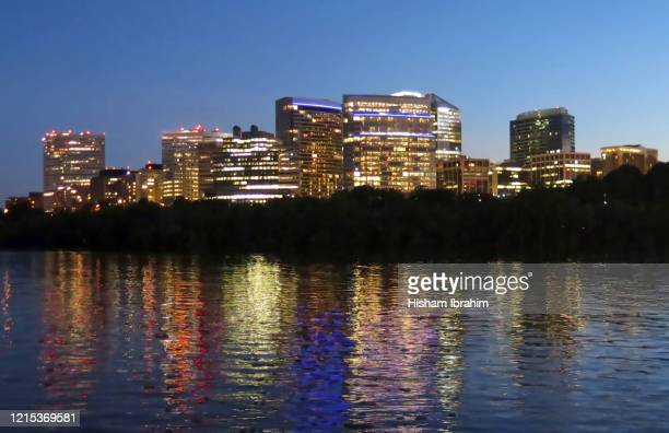 the skyline of rosslyn in arlington county, and the potomac river at dusk, virginia, usa - arlington virginia stock pictures, royalty-free photos & images