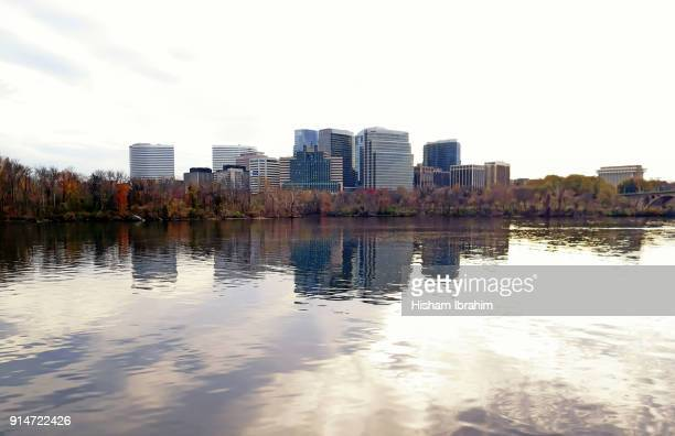 the skyline of rosslyn in arlington county, key bridge and the potomac river, virginia, usa - arlington virginia stock pictures, royalty-free photos & images