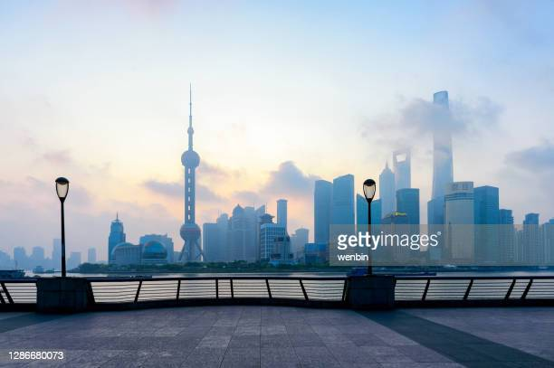 the skyline of shanghai in the mist - smog stock pictures, royalty-free photos & images