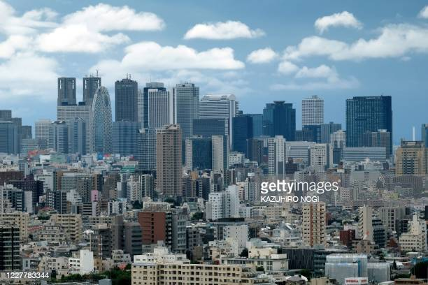 The skyline of skyscrapers in the Shinjuku shopping and business district is pictured in Tokyo on July 26, 2020.