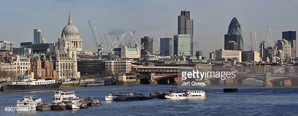 The skyline of the City of London seen from Waterloo Bridge looking east St Paul's Cathedral Tower 42 and the Gherkin are all visible River Thames...