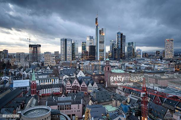 The skyline of the city's finance and banking district stands on a cold evening on January 13 2017 in Frankfurt Germany Many European banks are...