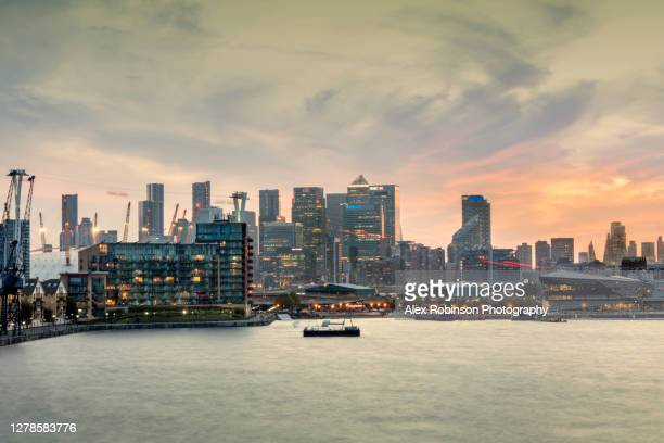 the skyline of the london financial district showing the millennium dome and the victoria dock - the o2 england stock pictures, royalty-free photos & images