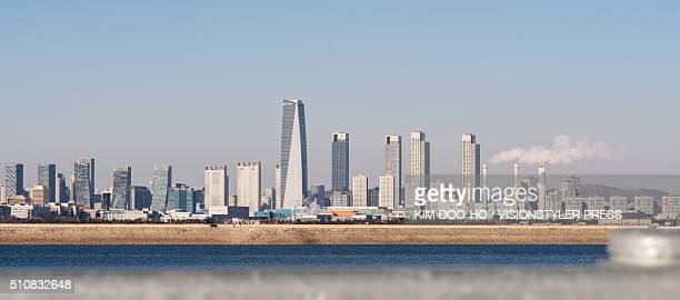 the skyline of the songdo international city - songdo ibd stock pictures, royalty-free photos & images