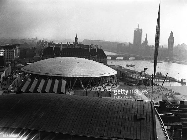 The Skylon rises above domed exhibtion buildings constructed on the south bank of the River Thames for the 1951 Festival of Britain