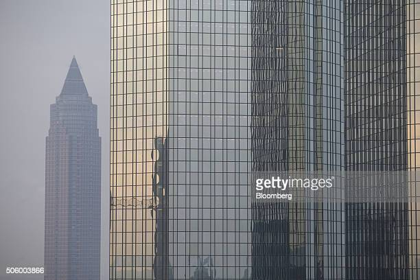 The skyscraper headquarter offices of Deutsche Bank AG right and the Messeturm building stand in Frankfurt Germany on Thursday Jan 21 2016 Deutsche...