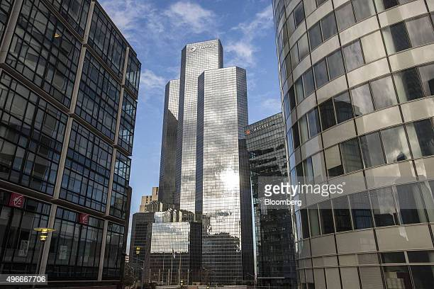 The skyscraper headquarter offices of Total SA center stand in La Defense business district in Paris France on Tuesday Nov 10 2015 Slumping values in...