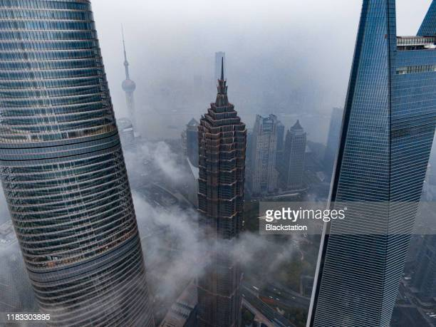 the skyscraper towers in lujiazui cbd in shanghai - skyscraper stock pictures, royalty-free photos & images
