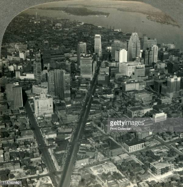 The Skyscrapers of Downtown Detroit from An Airplace View over Michigan Ave to Detroit River and Belle Isle Park' circa 1930s Street plan devised by...