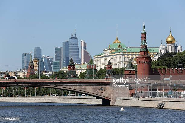 The skyscrapers of Moscow City business district left stand on the horizon beyond the Kremlin right on the banks of the Moscow river in Moscow Russia...