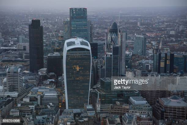 The skyscrapers of the City of London are seen from the Shard the tallest building in the European Union as the sun sets on March 28 2017 in London...
