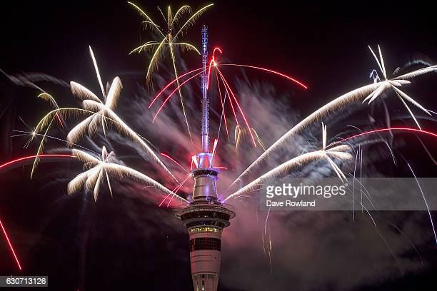 The SkyTower firework display during New Year's Eve celebrations on January 1 2017 in Auckland New Zealand The pyrotechnic display includes 500kgs of...