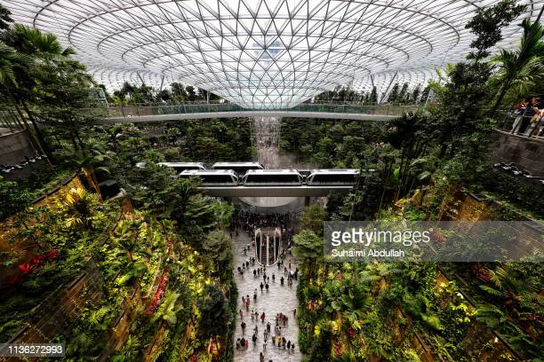 The skytrain rides past the Rain Vortex at the Jewel Changi Airport on April 11 2019 in Singapore Officially opening on April 17 Singapore's Changi...