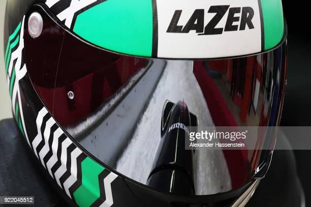 The sled is reflected in the visor of Seun Adigun of Nigeria as she and Akuoma Omeoga slide during the Women's Bobsleigh heats on day twelve of the...
