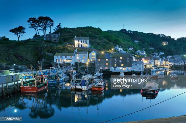 The sleepy Cornish fishing village of Polperro captured during blue hour.