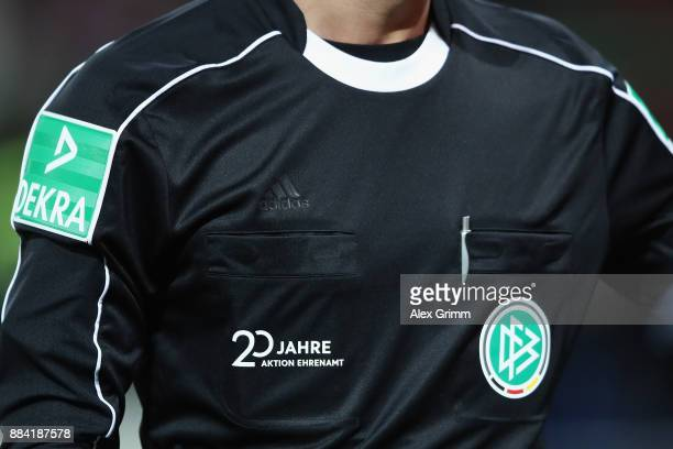 The slogan '20 Jahre Aktion Ehrenamt' is seen on the jersey of referee Benjamin Brand during the Bundesliga match between SportClub Freiburg and...