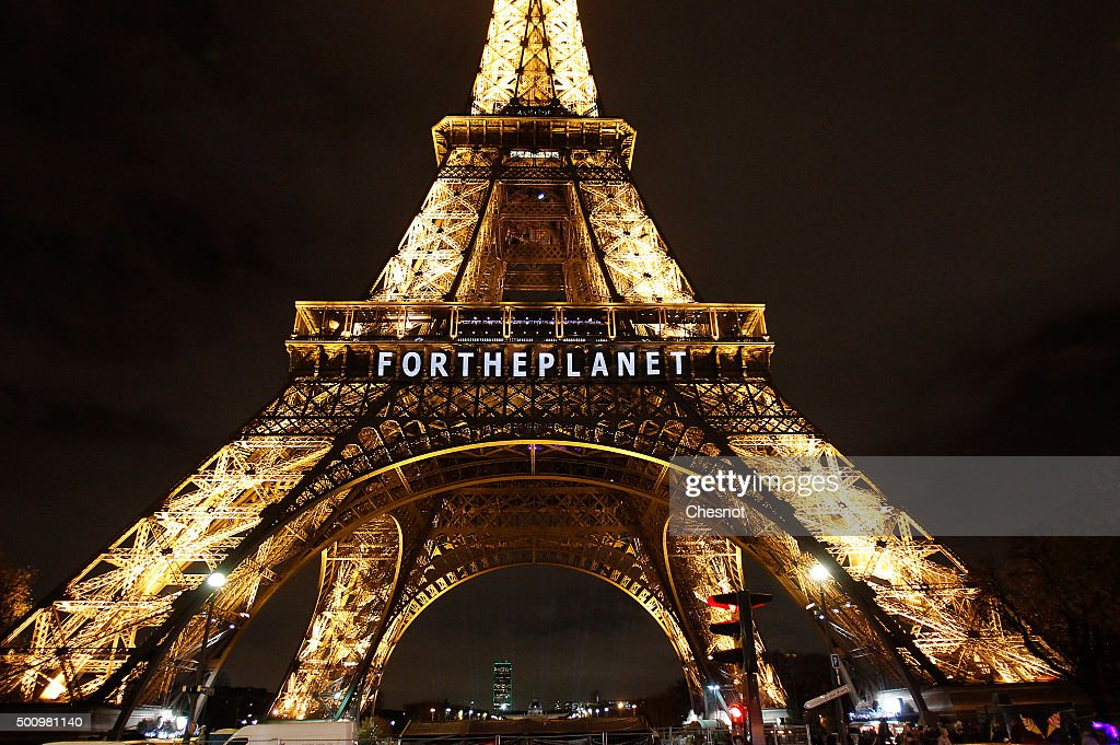 The Eiffel Tower Displays Messages As Part Of 21st Session Of Conference On Climate Change COP21 In Paris : News Photo