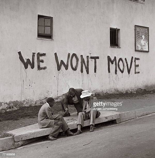 The slogan 'We Won't Move' appears on a wall in Sophiatown a suburb of Johannesburg 1955 In 1955 the Group Areas Act allowed the government to...