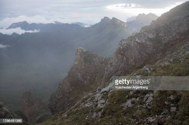 the slopes of asbestnaya mount in fog and clouds, adygea, caucasus mountains - argenberg stock pictures, royalty-free photos & images