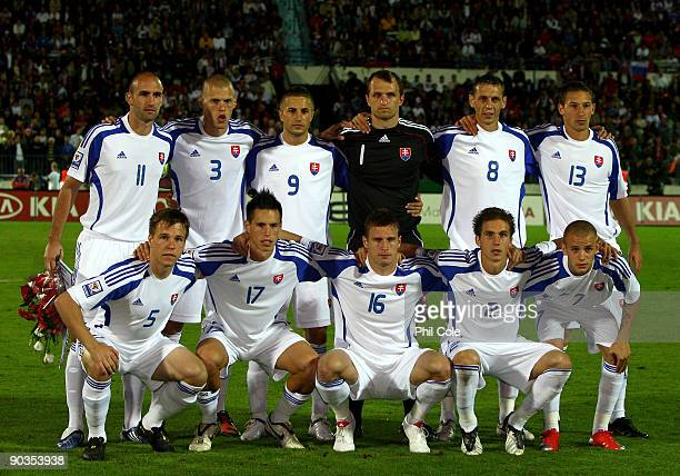 The Slovakia team pose for a group photograph during a World Cup Qualifiying Group 3 Match between Slovakia and Czech Republic at the SK Slovan...