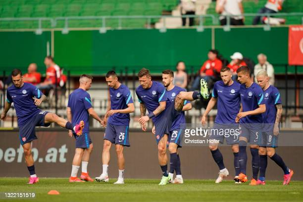 The Slovakia team warm up prior to the international friendly match between Austria and Slovakia at Ernst Happel Stadion on June 06, 2021 in Vienna,...
