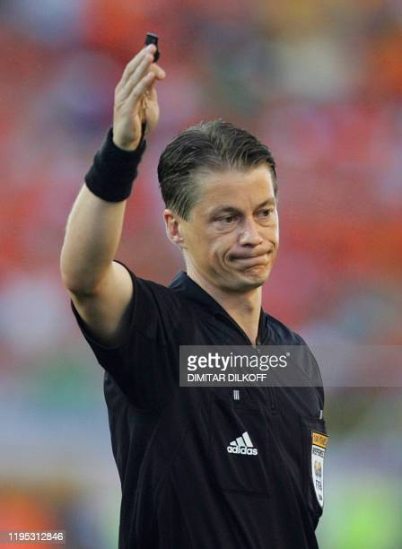 The Slovakian referee Lubos Michel gestures, 26 June 2004 at the Algarve stadium in Faro, during the Euro 2004 quarter final match between Sweden and...