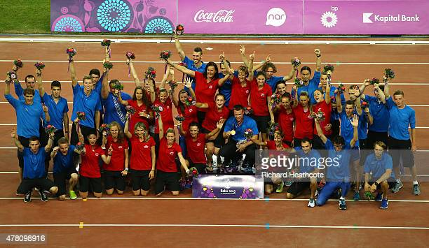The Slovakian team pose on the medal podium after winning the Team Athletics Championship during day ten of the Baku 2015 European Games at the...