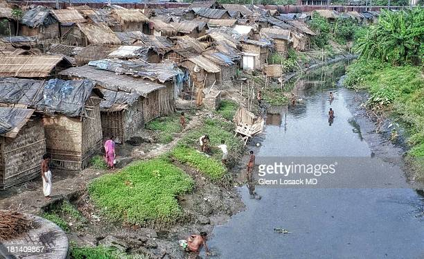 The slums/ bustees of TALI NULA KOLKATA INDIA this mirky absolutely foul and stagnant creek is seen being used as a toilet, a kitchen sink, a bath, a...