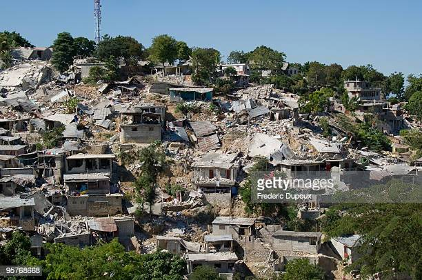 The slums of Canape Vert are devastated following a major quake January 14 2010 in PortauPrince Haiti Planeloads of rescuers and relief supplies...