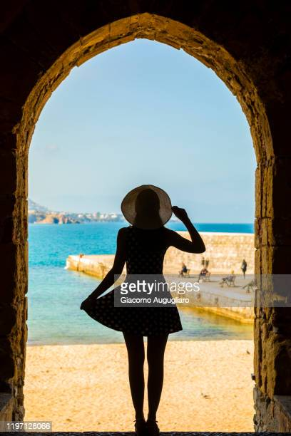 the small beach of cefalù viewed through an arch, palermo province, sicily, italy - giacomo palermo stock pictures, royalty-free photos & images