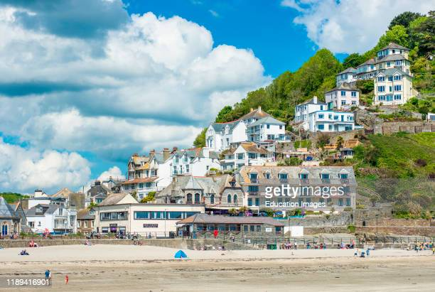 The small coastal town of Looe with hillside houses and a beach Cornwall UK