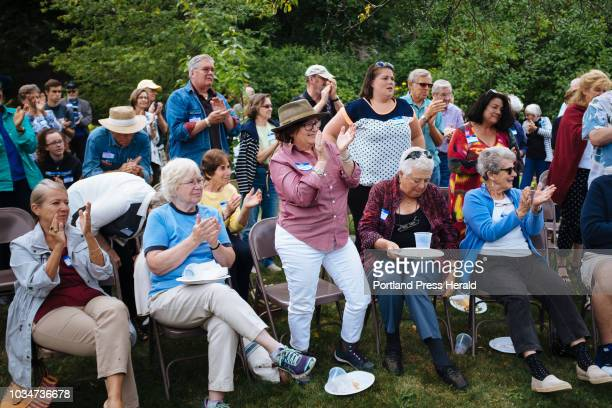 The small crowd at a Democratic picnic in South Portland stands up and applauds after Attorney General and Democratic Gubernatorial candidate Janet...