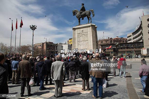 The small crowd surrounding the rally of retired diplomats and relatives of victims of Armenian radicals attacks in front of Atatürk Monument in Ulus...