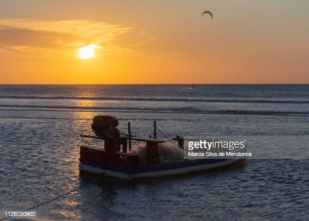 The small fishing boat is ready to go out to sea, during sunset in Jericoacoara beach.
