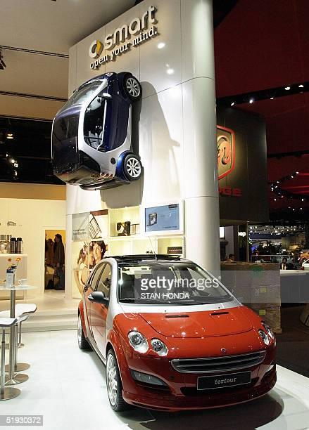 The smart car Fortwo and Forfour made by MercedesBenz are pictured 09 January 2005 during the North American International Auto Show at Cobo Hall in...