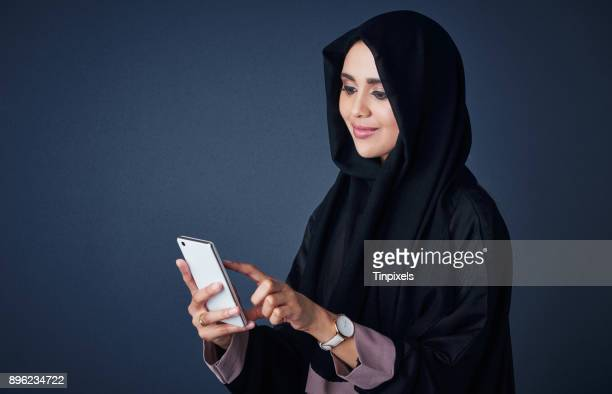 the smartest way of communication for her - muslim woman darkness stock photos and pictures
