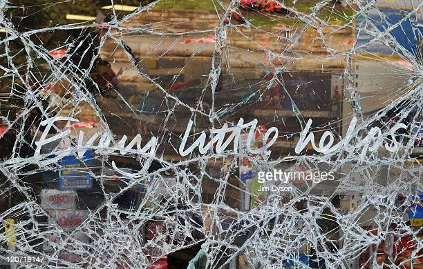 The smashed windows of a Tesco supermarket in Haven Green following a night of rioting in Ealing on August 9 2011 in London England Sporadic looting...