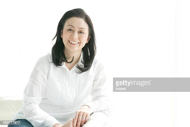 The smiling face of middle-aged woman