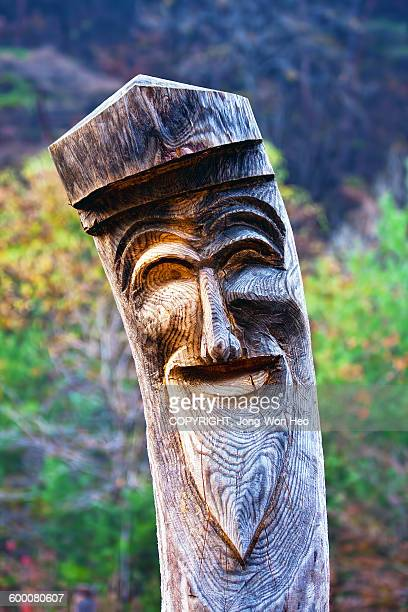 The smiling Korean traditional totem pole