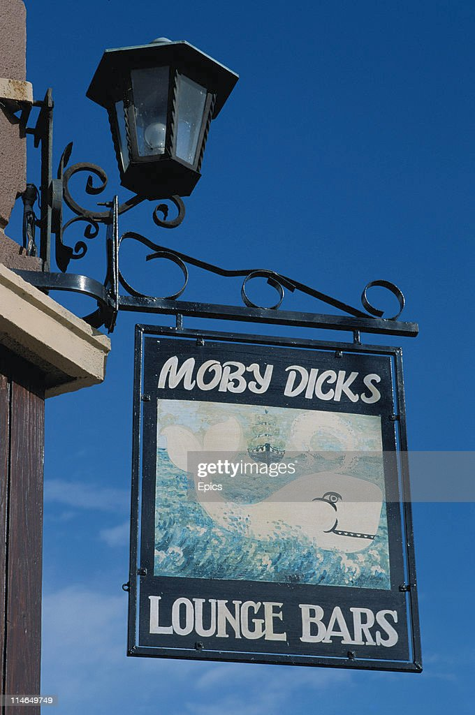 The smiling white whale on a sign for Moby Dick's public house in the town of Youghal, County Cork, Ireland, circa 1992 The town was the location for the filming of John Huston's film Moby Dick starring Gregory Peck in 1956.