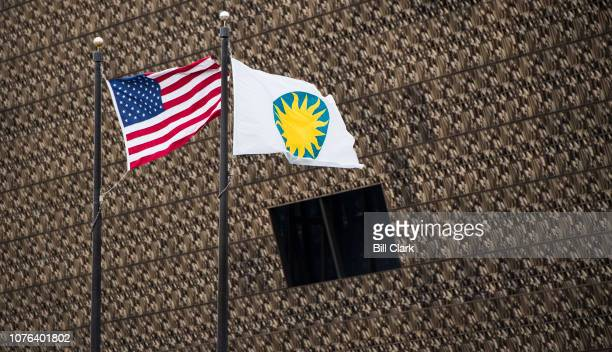 The Smithsonian and U.S. Flags fly in front of the National Museum of African American History and Culture on Tuesday, Jan. 1, 2019. All Smithsonian...