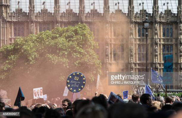 The smoke from a flare hangs in the air as thousands of protesters gather in Parliament Square after taking part in a March for Europe through the...