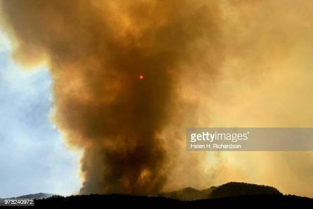 The smoke from the 416 fire obscures the sun as it continues to burn on June 12 2018 in Durango Colorado The fire burning 23 miles northwest of...